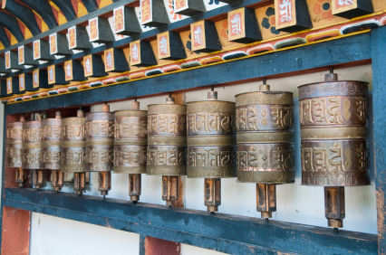 Bhutan row of traditional prayer wheels